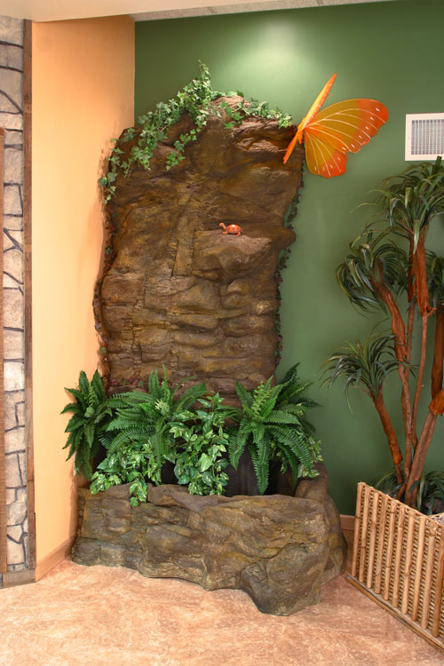 A rock wall in the room's corner.